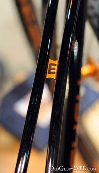 tiny cross brace with a custom E between the top tubes