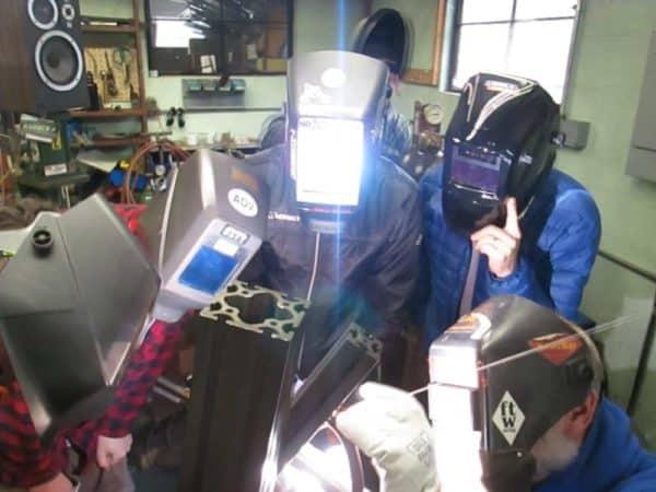 students watching welding demonstration